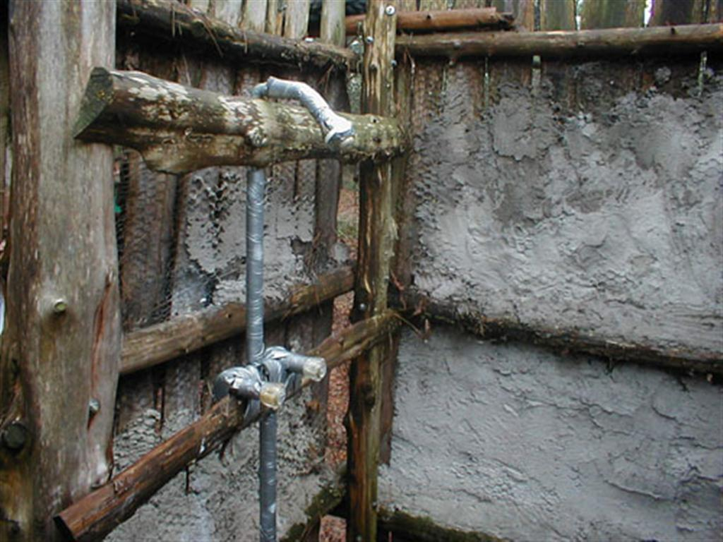 Water hole where children at therapeutic foster camp are forced to shower year round.